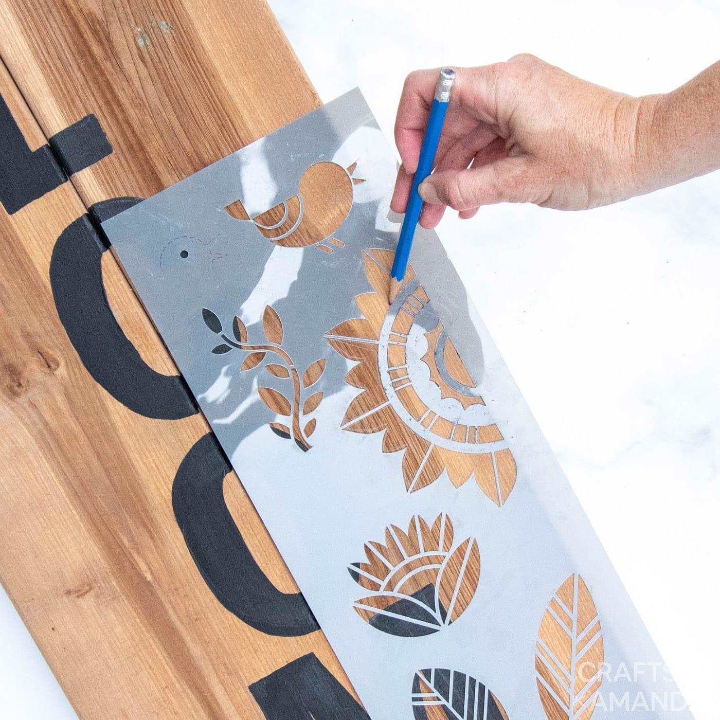 tracing stencil onto wooden board