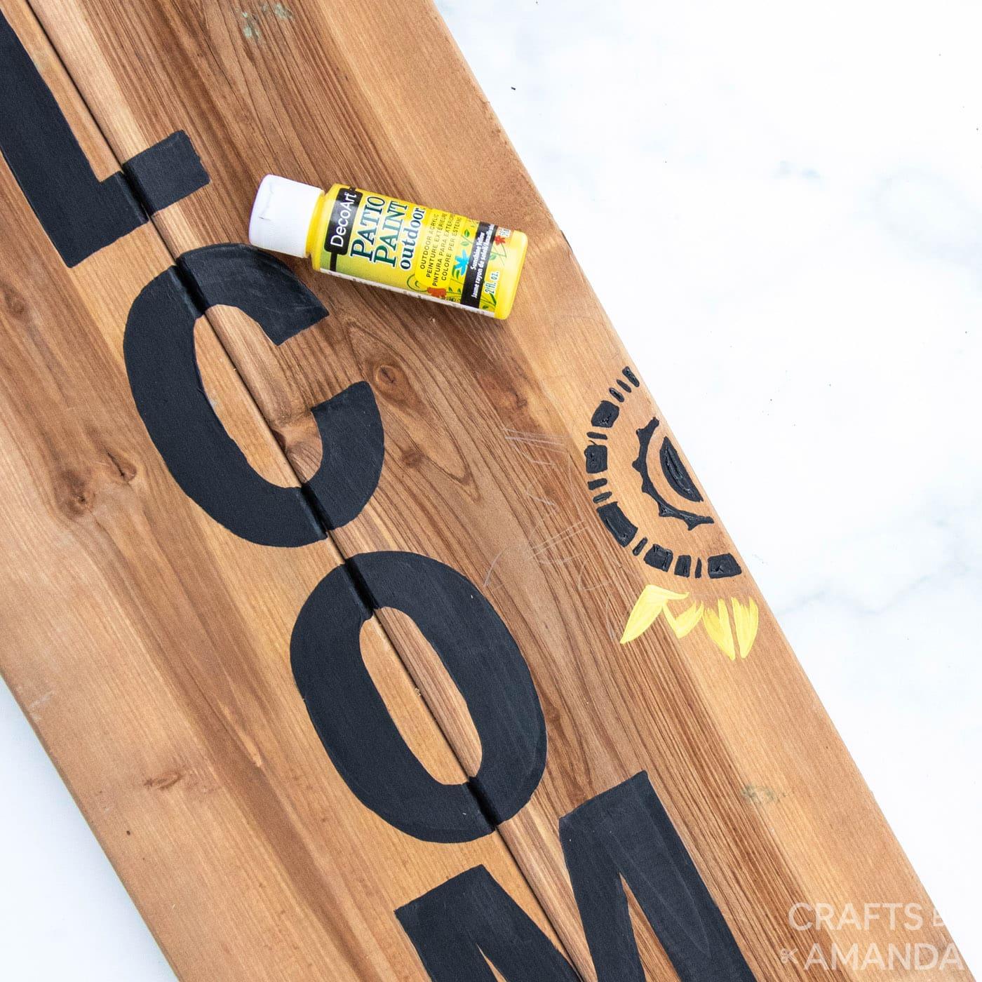 decoart paint on a wooden board