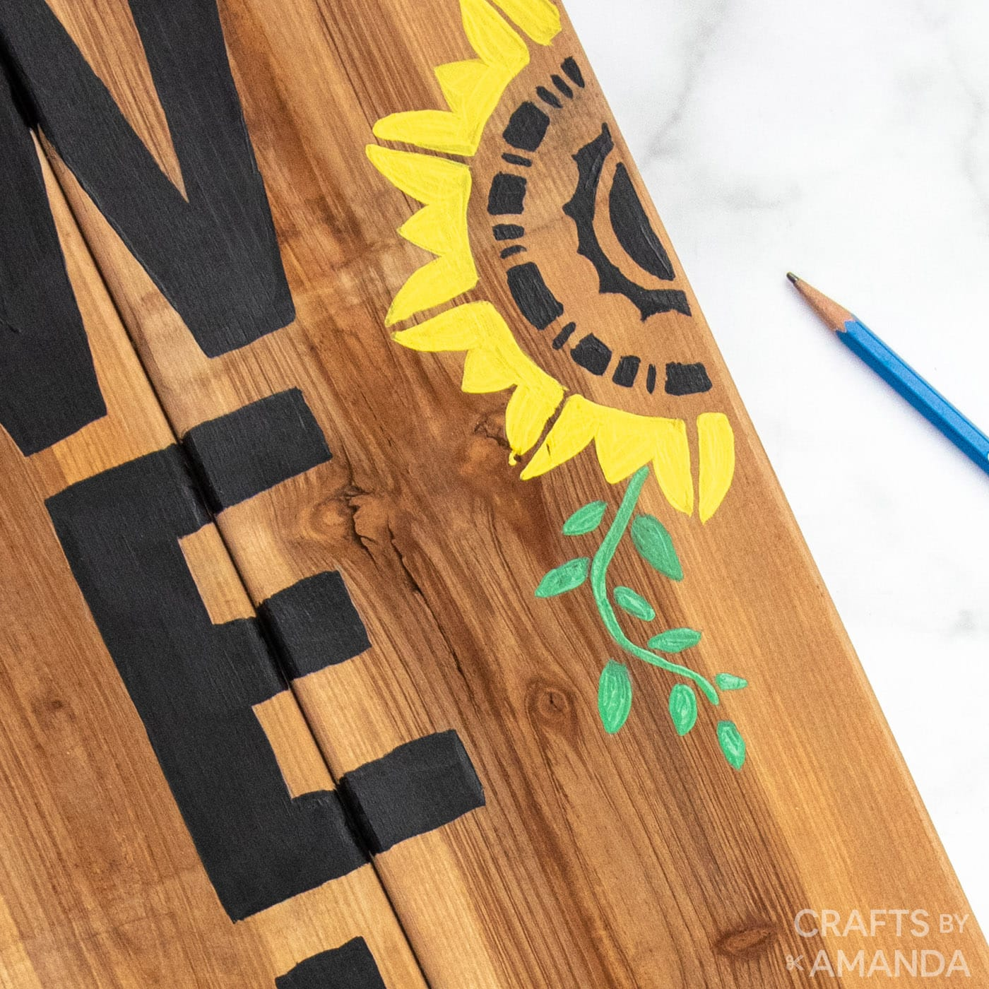 painted sunflower on a wooden board