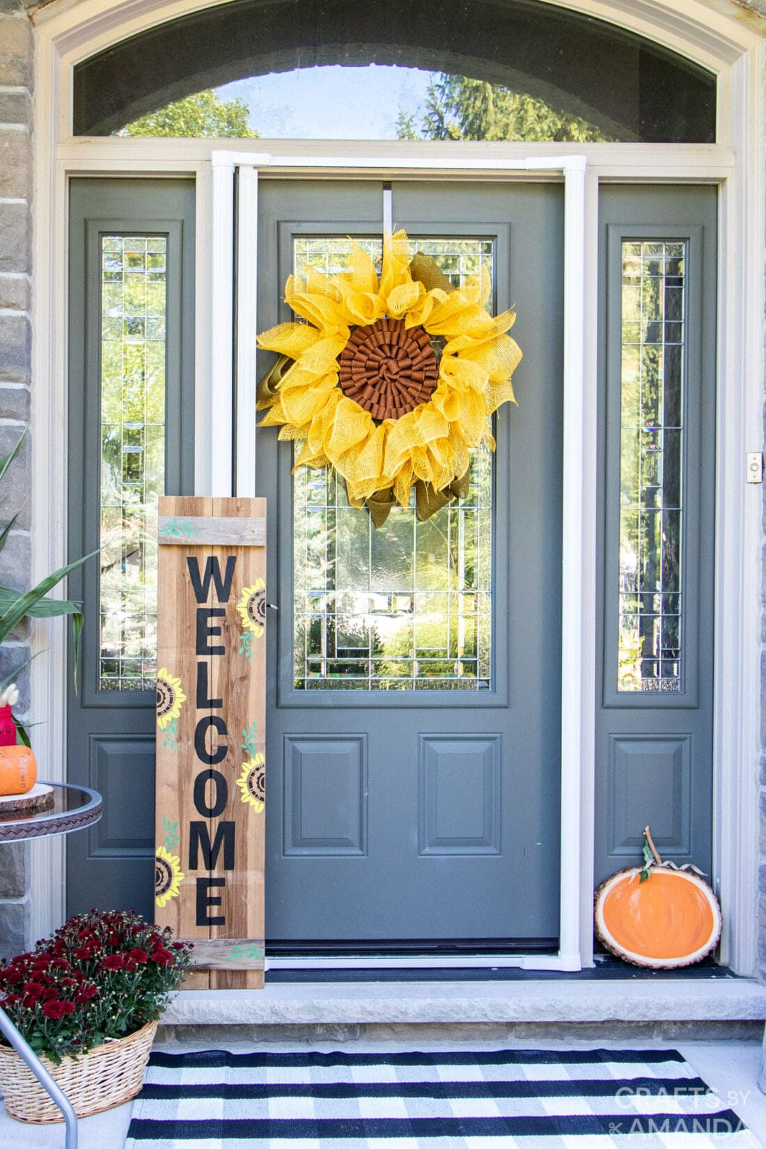 Sunflower Welcome Sign next to the door